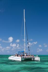 White catamar on turquoise ocean near Cayo Blanco, Cuba