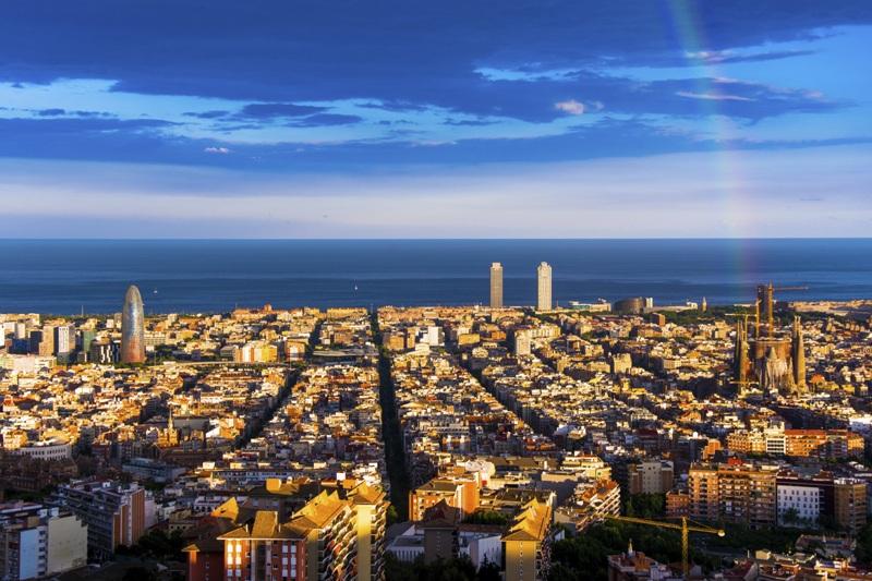 rainbow and barcelona skyline